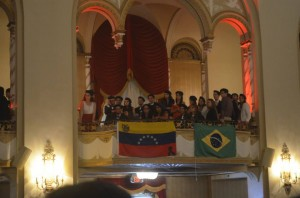 Waving flags during the closing ceremony of the HNMUN 2014 at the Boston Park Plaza.